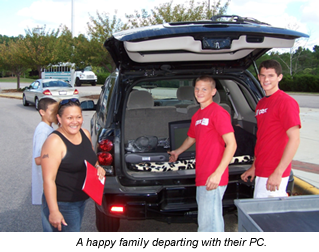 Photo of Family departing with their refurbished PC
